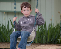 Christopher on a Swing